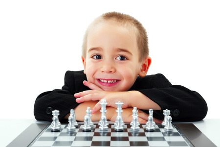 Happy little boy ready to play chess photo