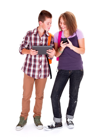 Teenager boy and his girlfriend looking at each other's mobile device