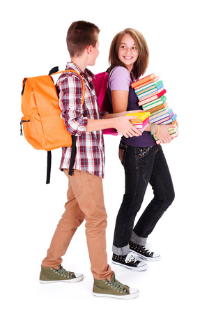 secondary education: Friends with bunch of books meeting again in school and chatting