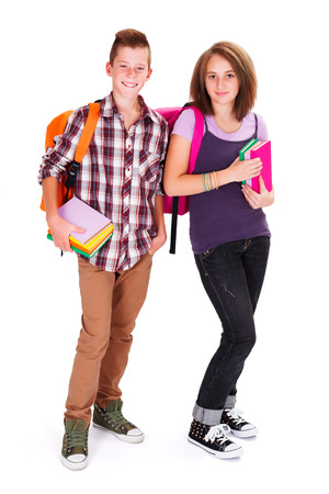 secondary: Two adolescent smiley kids with rucksack holding books in hands