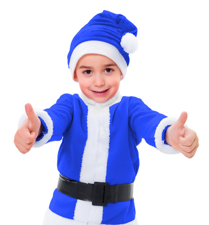 Little boy wearing blue Santa Claus uniform, showing double thumbs up photo