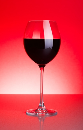 oenology: Glass of red wine on red