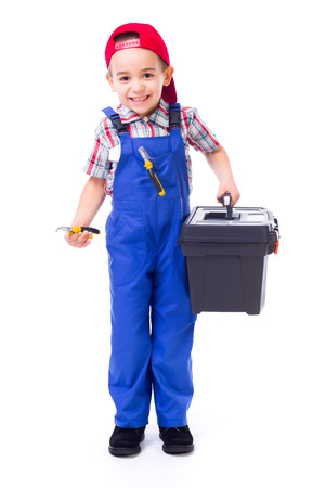 Happy little handyman boy carrying big toolbox and pliers photo