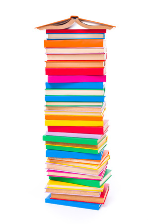 stacked books: Lots of stacked colorful books with spread book on top