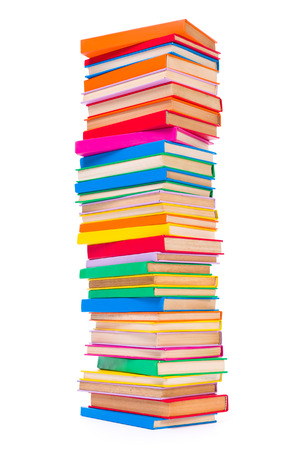 stacked books: Bottom view of stacked colorful books on white background Stock Photo