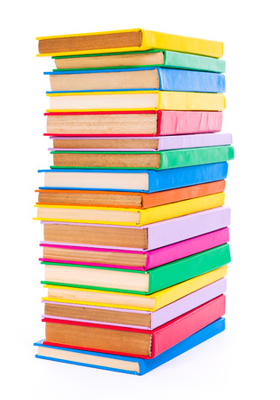 Lots of stacked colorful books on white background Stock Photo
