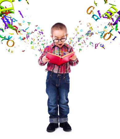 conceptual cute: Cute little boy wearing glasses, wondering of flying letters from a tale book
