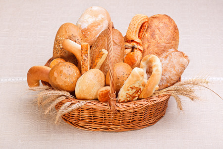 Various fresh bakery products in wicker basket