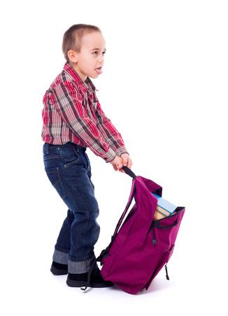 tried: Little boy tried of pulling a heavy schoolbag