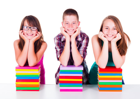 secondary: Smiling students with stacked colorful books