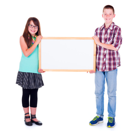 Boy and girl holding an empty framed advertising board photo