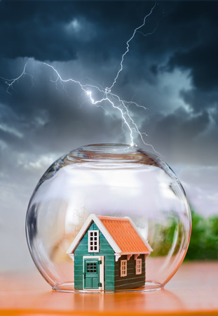 thunderstorm: Insured house under protection, during natural calamities Stock Photo