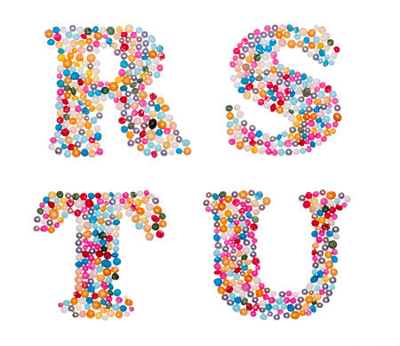 u s a: Letter set made of colorful sprinkles - capital letters R S T U