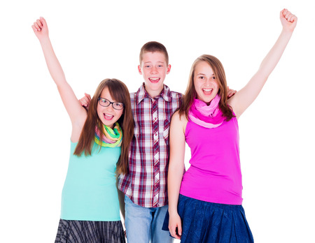 Teen boy with happy girls raising their hands Stock Photo