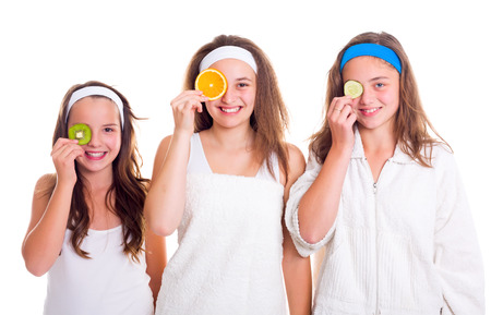 primp: Primping teenager girls having fun with fruit slices Stock Photo