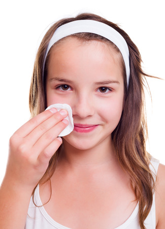 cotton pad: Teenager girl cleaning her face with cotton pad