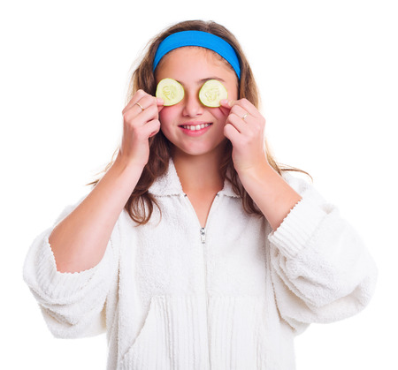 primp: Teenager girl with cucumber slices over her eyes Stock Photo