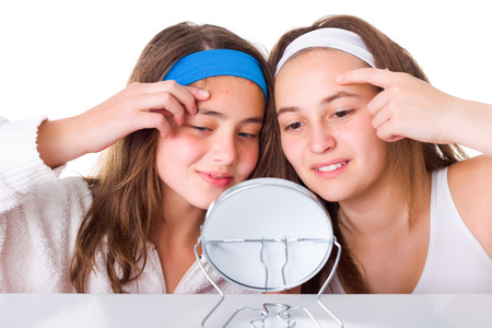 blemishes: Teenager girls searching for blemishes on theirs skin