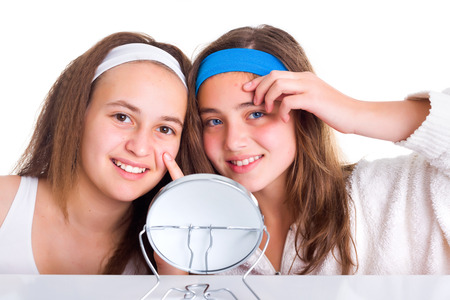 blemishes: Teenager girls showing the blemishes on theirs skin