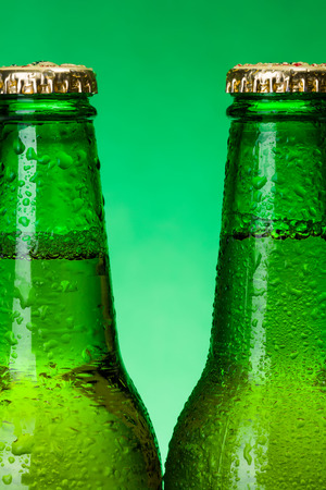 green beer bottle: Macro of wet green beer bottle necks Stock Photo