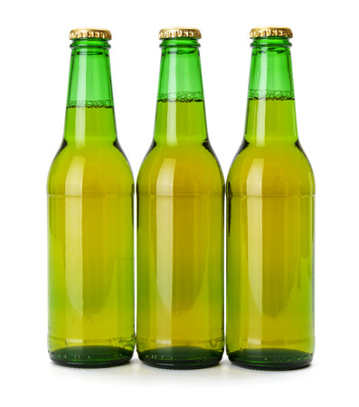 cool backgrounds: Green beer bottles on white background Stock Photo