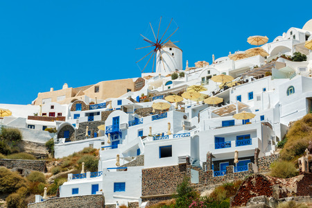 eclectic: Windmill and eclectic style apartments in Oia town, Santorini island, Greece Stock Photo