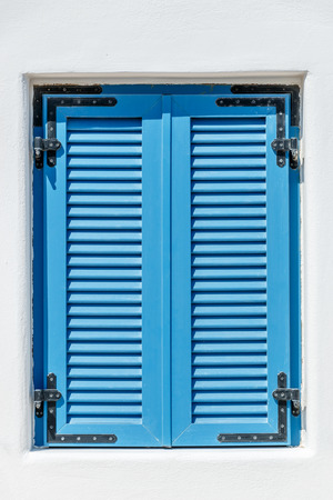 bahama: Closed blue window with Bahama shutters Stock Photo