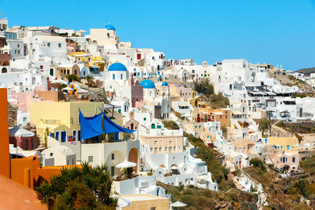 eclectic: View on the colorful, eclectic buildings in the south part of Oia town, Santorini island, Greece