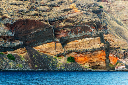 rock layers: Santorini island, Greece. Colorful layers of calderas inner volcanic wall