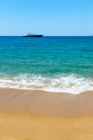 water transportation: Golden sand and azure sea on Ios island, Greece