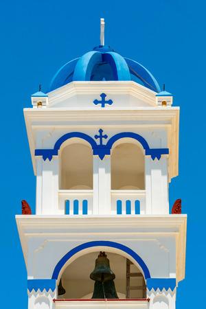 religious building: Greek church bell tower Timiou Stavro in Perissa, Santorini island, Greece