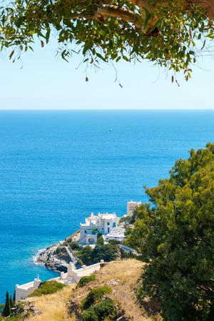 ios: White hotels on the blue sea side on Ios island, Greece