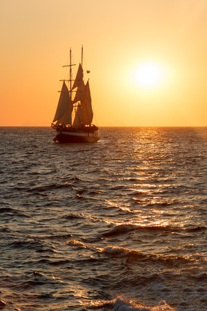 water transportation: Sailing ship silhouette in red sunset on the sea Stock Photo