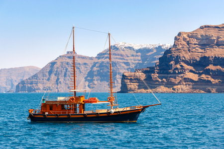 clear water: Greek sailing ship on the sea, aproaching the harbor Stock Photo
