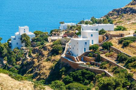 greece: White hotels on the blue sea side on Ios island, Greece