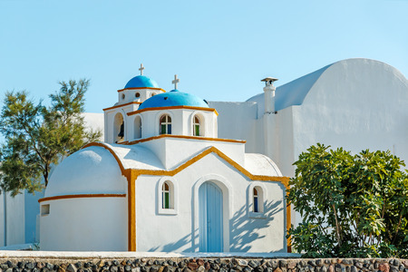 religious building: Tiny Greek church with blue dome on Santorini