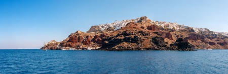 clear sky: Wide panorama of Oia town from the sea on Santorini island, Greece Stock Photo