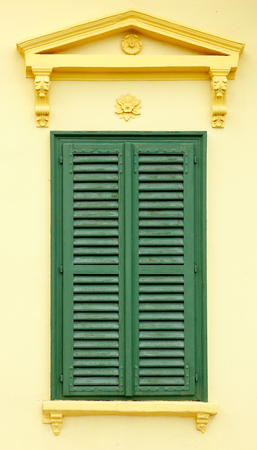 bahama: Front view of neoclassical window with green wooden Bahama shutters