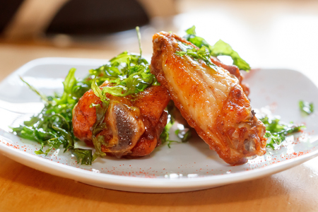 arugula: Served fresh roasted chicken wings with arugula