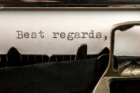 regards: Macro of Best regards text written by old typewriter machine