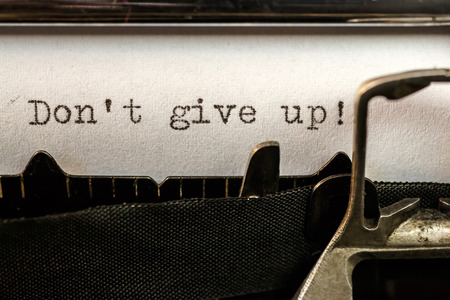Macro of Don't give up! text written by old typewriter machine