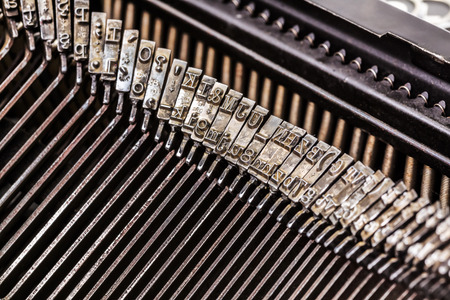 type bar: Macro of old typewriter letters on type bar Stock Photo