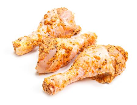 Marinated raw chicken drumsticks on white background Stock Photo