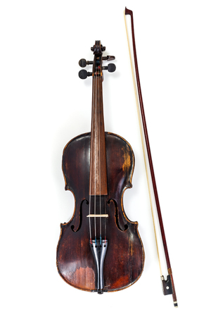 Used old classical violin with bow on white background