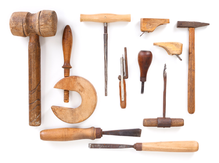 Different violin maker work tools on white background