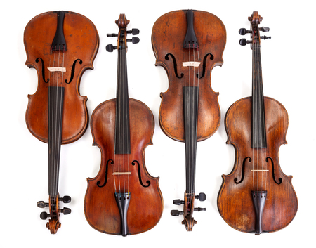 Top view of old violin collection on white background Banque d'images