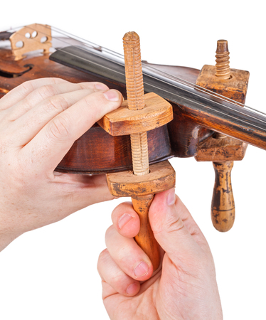 Using the wooden clamps on violin body - close view