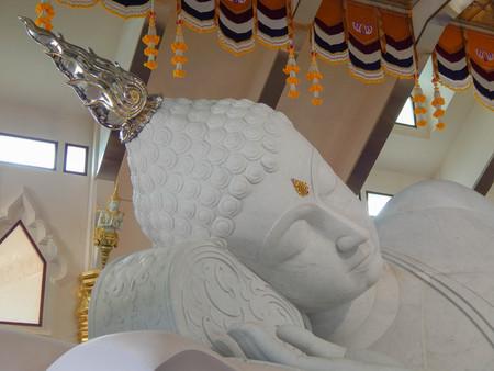 biggest: The biggest white marble nirvana Buddha in a public temple, Wat Pa Phu Kon,Thailand