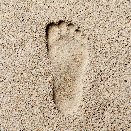 stoneage: Footprint in sand, hi contrast style, stoneage