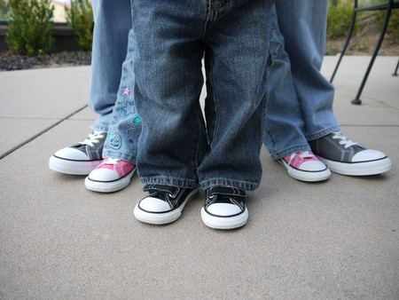Family showing legs and shoes, from large to small.